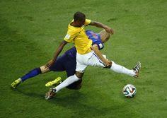 Arjen Robben of the Netherlands fights for the ball with Brazil's Fernandinho. REUTERS/Ruben Sprich