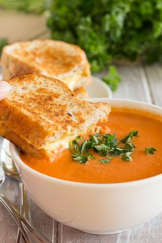 Creamy Tomato Soup with Basil, Onion, & Blended Cashews _ And then, there are vegan grilled cheese sandwiches. Whaaaaaat?? I can taste it now–crunchy, ooey gooey grilled cheese sandwiches dipped in warm, creamy tomato soup & stuffed in my mouth faster than a fighter jet on a mission.