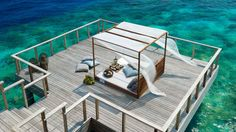Helen Keller said that the most beautiful things in the world cannot be seen or even touched, they must be felt with the heart. While this is absolutely true,  these 15 over-water terraces from top luxury hotels in Maldives might make you question the statement for a moment or two. (Joke!)