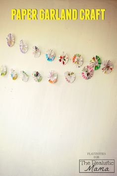 Recycled Paper Garland Craft. Love how simple this is and perfect for holiday decorations!