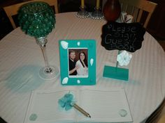 Reception guest book and pen, picture frame, chalk board,beautiful tall candle holder