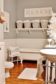 Bellani's Bathroom - Shelf w/ hydrangeas in 4 or 5 vases, All of Me canvas over towel rack