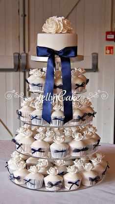 Blue and White Wedding Ideas - Cupcake Wedding Cake with Navy Blue Ribbon...fun and elegant!| Bridal Guide Magazine