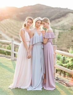 Joanna August // Cold-shoulder, off-the-shoulder and modern bridesmaid dresses in pastel hues - blush pink, pale misty blue, and light lavender