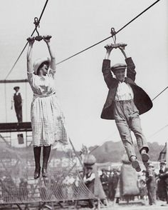 A couple enjoys an old fashioned zipline on a weekend afternoon. (1923) -- Millennials think they are so creative. ha! Since 1923 ya x-gamers!