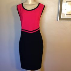 "Louis Feraud Dress Gorgeous sheath dress.  Colors are pink and navy blue.  Very classic look. In great condition. Measurements taken flat are 38"" length, 18"" bust, 16"" waist, 22"" hips.  Fully lined.  Zipper in back.  Reasonable offers welcome.  Please use OFFER to negotiate.  No trades.  Bundle and save. Louis Feraud Dresses"