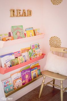 This sweet nursery from Debby of @time2diyblog has everything you're looking for in a girl's bedroom makeover. With storage ideas for a reading nook and gold floral wall decals, there's so much to love in this pink space.