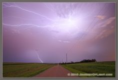 An intense lightning storm in rural eastern Nebraska lights up the sky with bolts extending in all directions. - Photograph, Image, Picture