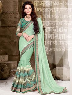 Net & Shimmer Georgette Saree with scattered zari, resham embroidery and work. Item code: SUM3183 http://www.bharatplaza.com/new-arrivals/sarees.html