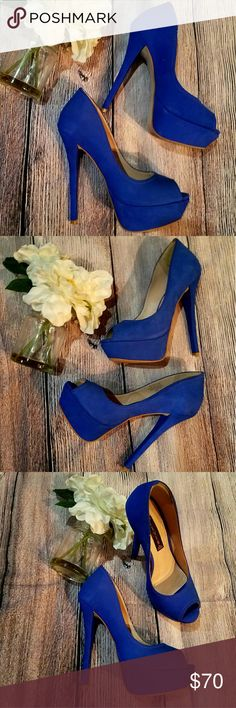 STEVE MADDEN  ALTITUDE HEELS SZ 9 ROYAL BLUE BEAUTIFUL STEVEN BY STEVE MADDEN HEELS SKY HIGH 6.5 INCHES GORGEOUS ROYAL BLUE COLOR SZ 9M  IN PRELOVED CONDITION  FLAWS: SHOES OBTAINED A FEW SCUFFS DUE TO WEAR. PLEASE SEE LAST PICTURES! Steven by Steve Madden Shoes Heels