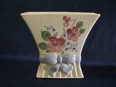 """The mold for this hand-painted vase by the California Figurine Company, c. 1946, originated as a May and Vieve Hamilton design for Vernon Kilns. Max Weil evidently purchased this retired mold, also around 1945, from Vernon Kilns. It is doubtful the Hamilton sisters were consulted on the hand painted flowers decorating their """"Milady"""" vase shape."""