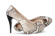 Stilettoes made of engraved snakeskin on a thin high heel is the symbol of rebellion, which ornate with Swarovski multi-coloured crystals speaks volumes about its beauty and power. More on: http://mysfashion.com