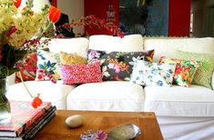Colorful floral throw pillows on white couch