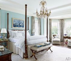 Elegant, tailored, and classic master bedroom in a Houston home decorated by Elissa Cullman is made light and bright in a cool shade of aqua.