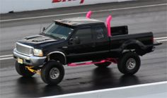 -- now thats a FORD! .. girl rocking hot pink stacks!!! Hmm.. wonder if I can talk Chris into putting them on his truck since mines gasoline! =)