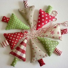 fabric christmas trees - reminds me of the ornaments we made when I was a little girl Fabric Christmas Trees, Christmas Tree Garland, Noel Christmas, Christmas Projects, Winter Christmas, Christmas Tree Ornaments, Holiday Crafts, Christmas Material, Xmas Trees