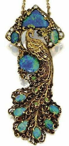 Gold, Black Opal, Diamond and Demantoid Garnet Peacock Pendant-Necklace, Walton & Co., Circa 1900. The stylised peacock amidst a grapevine motif set with triangular-shaped, oval and pear-shaped black opals, accented by old European-cut diamonds and various-cut demantoid garnets via Sothebys archives