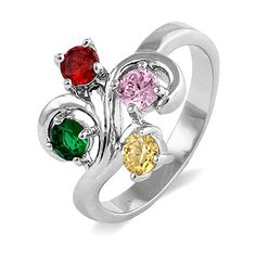 Our Close To The Heart 4 Stone Swirl Birthstone Ring is simple but lovely. Made of shining sterling silver, this custom ring holds four shimmering birthstones of your choosing to represent those you hold dear. Or just pick the gemstones that you think look great, creating your own custom ring! Swirls of lustrous silver wrap around 4mm stones, hugging them close together. Have the inside of the band engraved with a special name or date to make this absolutely one-of-a-kind. This is the…