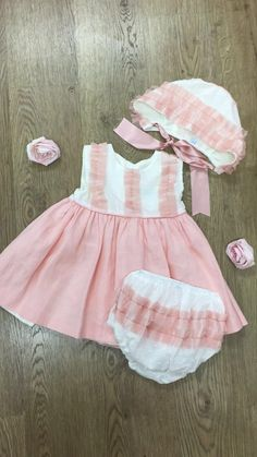 This beautiful dress comes with a cute bonet and frilly jam pants :)