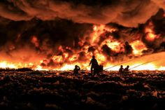 West Midlands Fire Service/Reuters July 1, 2013. Firefighters tackle a large blaze at a recycling center in Smethwick, near Birmingham, central England in a handout picture ..