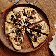"""Mushroom-and-Goat Cheese Béchamel Pizzas - I can think of ideas to use this Goat Cheese Béchamel base for a number of  different """"white pizza"""" toppings"""