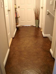 hmmmmm... Maybe instead of hardwood, we could do this! paper bag floors!