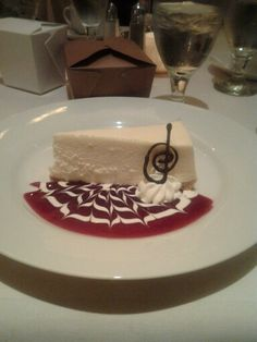 Creamy and delicious cheese cake with an amazing raspberry sauce on the side...also with a little chocolate ganache on the side....this cheese cake can be found at  Frasers in Oak Harbor, WA. Best cheesecake I have ever had in my life and the food is amazing food.