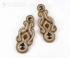 Beige Swarovskimi earrings with crystals, jasper beads and tiny Japanese toho. Are lined with beige leather, impregnated, non-allergenic earwires.  length 7.5 cm. width of about 3 cm.  AVAILABLE, email me