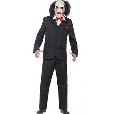 Saw Jigsaw kostuum voor heren. Compleet Jigsaw verkleed kostuum bestaande uit een latex masker, vest en het T-shirt. Het kostuum is one size en geschikt voor volwassenen.