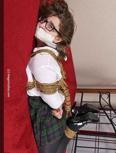 Schoolgirl tied to the bed