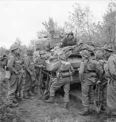 Infantry about to clamber aboard Sherman tanks during the assault on Venraij, 17 October 1944.