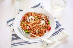 Spaghettini with Fresh Clams, Sausage, Cherry Tomatoes, Edamame, Chili and Flat Leaf Parsley