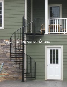 Spiral staircase poolside to deck in Rocky Mount Virginia by Appalachian Ironworks