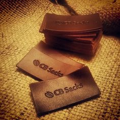 leather logo patches ready to be sewn onto bulap #rusticfashion #coffee