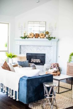 beautiful neutral pops of fall decor and lots of texture in this fall living room home