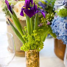 Gorgeous Centerpieces on a Budget--small skinny vases cut down on amount of greenery and flowers