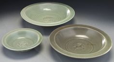 """Chinese Song Longquan celadon porcelain plates with twin fish motif on the center well. Notably, the smallest one has a fluted exterior wall. Largest: 8""""Dia"""