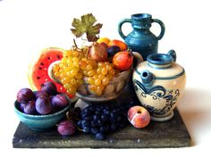 Fruit still life with teal pottery