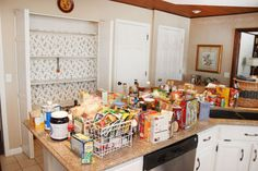This photo is from an article on kitchen organizing.  It suggests you start by taking everything out.  See the chaotic mess that makes? Go item by item and toss and categorize as you go.  On my kitchen counters you would see groups of related food. Make life easy for yourself when you organize!
