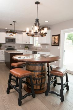 Whiskey Barrel Pub table with Leather Bar Stools with black base. Room designed and styled by Stone Barn Furnishings.