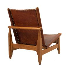 Pair of Leather and Walnut Lounge Chairs | From a unique collection of antique and modern lounge chairs at http://www.1stdibs.com/furniture/seating/lounge-chairs/