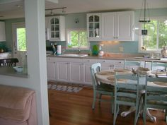 Lake House kitchen - the balance of soft blue and white is gorgeous.