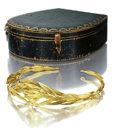 Cartier Archeological Revival Gilt-Metal Tiara, Circa 1930, overlapping textured laurel leaves.  Signed. (Sotheby's)