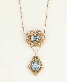 An antique gold, aquamarine and half-pearl pendant necklace  The central drop with fancy pear shaped aquamarine within a cannetille surround with half-pearl accents, to a similarly designed oval surmount with aquamarine centre, to fine link neckchain, drop and surmount circa 1830, converted circa 1900, neckchain detachable, with alternative brooch fitting, fitted case