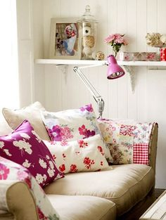 love the bright pillows and colorful patchwork quilt on a neutral sofa