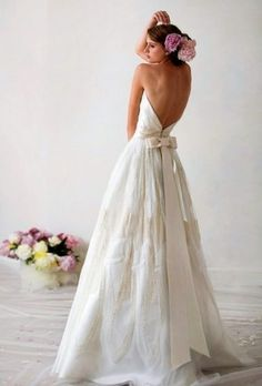 beach bride wearing lovely backless dress