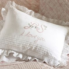 Cotton pillow with a ruffled trim and embroidered design.       Product: Pillow  Construction Material: 100% Cotton c...