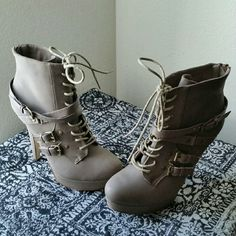 """JUST FAB....GORGEOUS TAUPE ..ANKLE..BOTTIES ....GOOD CONDITION  ....PRE-LOVED ....NORMAL WEAR... ....MINOR SCUFFS THROUGHOUT  ....GORGEOUS ....true to its Size  ....color... taupe ....2 pic up close ....tie lace up ....zipper on side  ....buckle straps ....bronze studs ....4 pic ...bottom sole ...condition  ....6"""" heel  ....better in person  ....SOLD AS IS..... ....PLEASE ...READ BEFORE PURCHASING. JustFab Shoes Ankle Boots & Booties"""