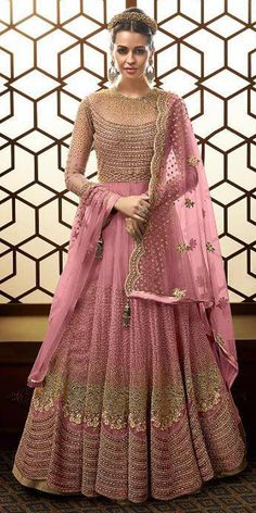 Georgeous Pink Net Anarkali Suit.This Designer Long anarkali has beautified with Heavy Embroidery and matching Net dupatta which gives you wedding look to you.