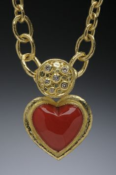 Coral Ox Blood Heart Pendant with white diamonds.